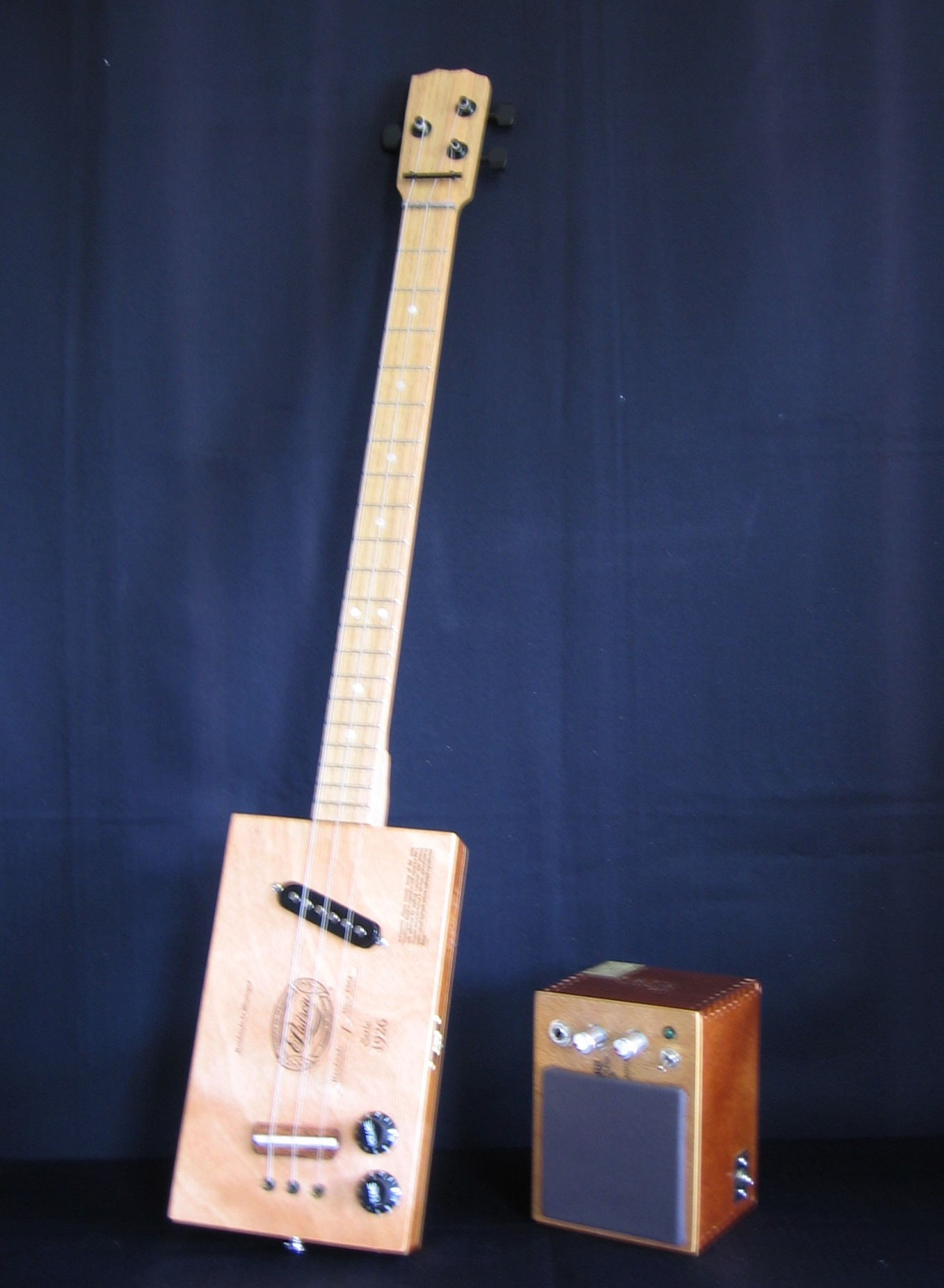 three string guitar and amp